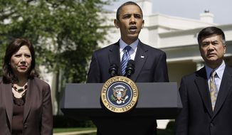 President Barack Obama, accompanied by members of his economic team, Labor Secretary Hilda Solis, left, and Commerce Secretary Gary Locke, makes a statement on the monthly jobs numbers, Friday, May 7, 2010, outside the Oval Office of the White House in Washington. (AP Photo/Carolyn Kaster)