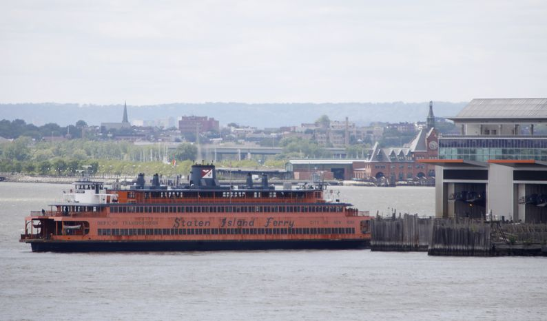 ** FILE ** A Staten Island ferry docks at the Manhattan terminal in New York on Sunday, May 9, 2010. The Staten Island ferry that malfunctioned and smashed into a pier, tossing passengers to the deck, has been idled while federal and local officials try to figure out what went wrong. (AP Photo/Seth Wenig)