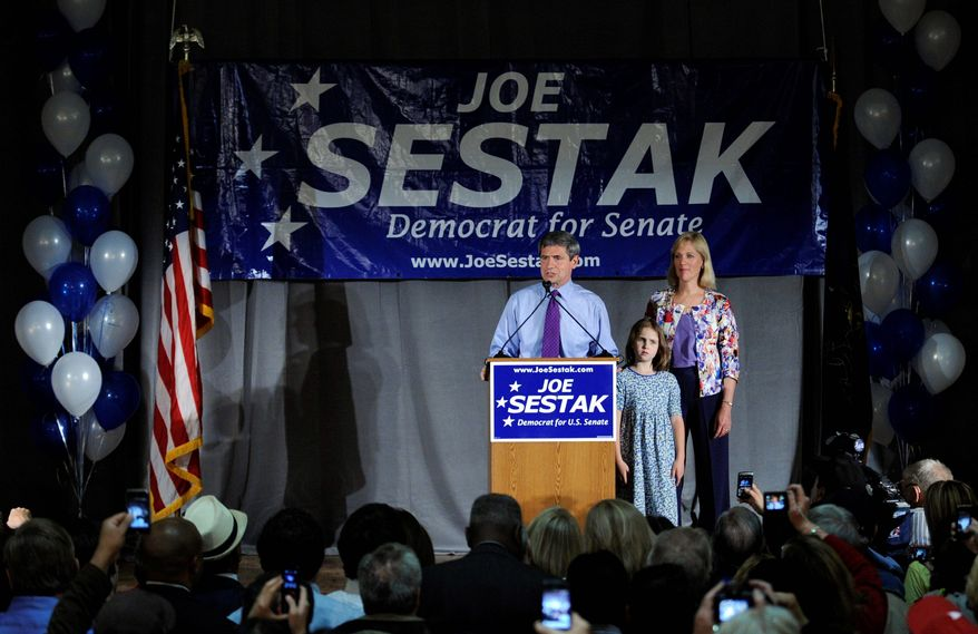 Sen. Joe Sestak, Pennsylvania Democrat, along with daughter Alex and wife Susan, speaks at a primary night event at the Valley Forge Military Academy & College in Wayne, Pa. He unseated incumbent Sen. Arlen Specter.