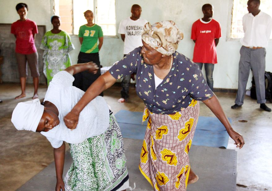 In Nairobi's Korogocho slum, one of Kenya's most dangerous areas, elderly women practice self defense moves. Elderly women in slums are increasingly being targeted by rapists. Officials say the rapists believe that attacking the older women can cure AIDS. Some believe that it will bring them good fortune, while others think it will cleanse their sins. (Associated Press)