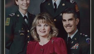 Lt. Col. Stephen D. McConnell is seen here in March 1998 with wife Kimberly, daughter Gretchen and son Tanner. Col. McConnell, 56, committed suicide on June 1 in Williamsburg, Va. (McConnell family photographs)