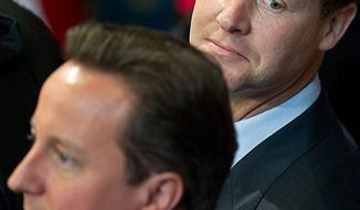 ** FILE ** British Prime Minister David Cameron (left), a Conservative, and Deputy Prime Minister Nick Clegg, a Liberal Democrat, wait to leave after attending the State Opening of Parliament in London on Tuesday, May 25, 2010. (AP Photo/Leon Neal, Pool)