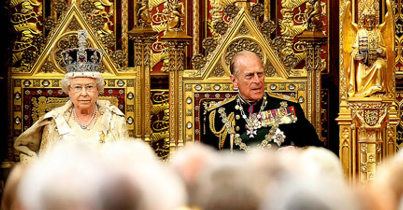 ** FILE ** Queen Elizabeth II sits on the throne beside Prince Philip in the House of Lords before delivering the Queen's Speech to open Parliament at the Palace of Westm