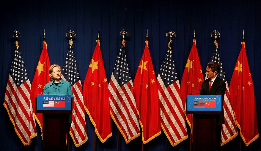 """Secretary of State Hillary Rodham Clinton (left) speaks as Treasury Secretary Timothy F. Geithner looks on during a press conference in Beijing on Tuesday, May 25, 2010. Mrs. Clinton stepped up pressure on China on Tuesday to back international action against North Korea for the sinking of a South Korean warship, calling peace and security on the Korean peninsula """"a shared responsibility"""" between Washington and Beijing. (AP Photo/Andy Wong)"""