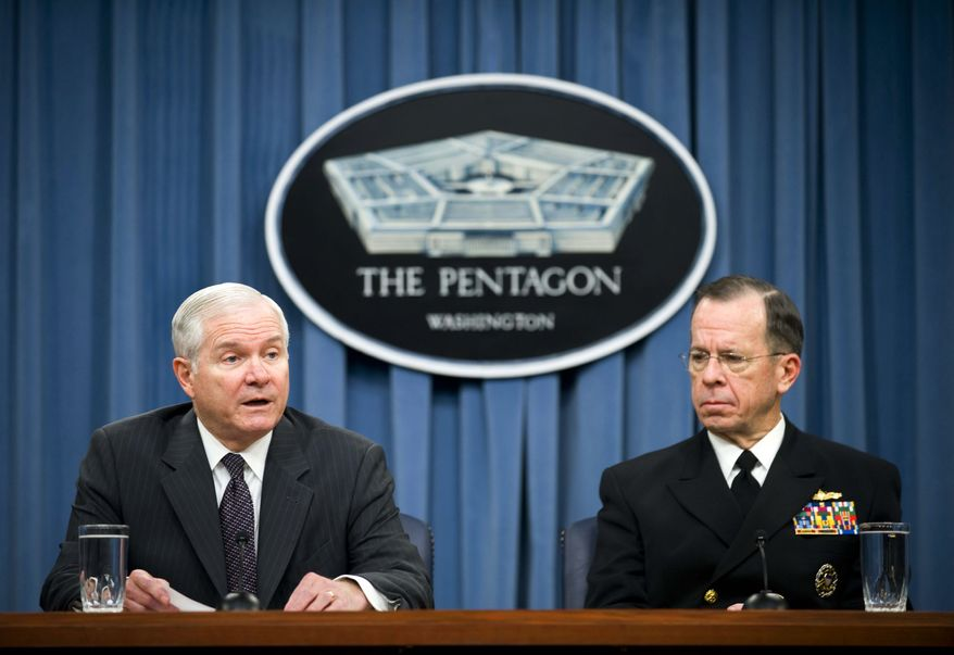**FILE** In this Feb. 1, 2010 photo, Defense Secretary Robert Gates (left) and Joint Chiefs Chairman Adm. Mike Mullen hold a briefing at the Pentagon. Mr. Gates on May 25, 2010, agreed to a proposal to repeal the military ban on gays. (Associated Press)