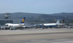 Lufthansa, United Airlines and Singapore Airlines aircraft at the San Francisco International Airport (Nicholas Kralev/The Washington Times)