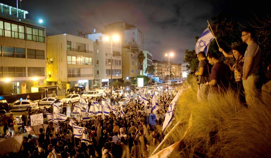 Hundreds of Israelis wave Israeli flags during a demonstration outside the Turkish Embassy in Tel Aviv on Monday in support of Israel after a deadly raid by Israel's navy on an aid flotilla bound for the blockaded Gaza Strip. (Associated Press)