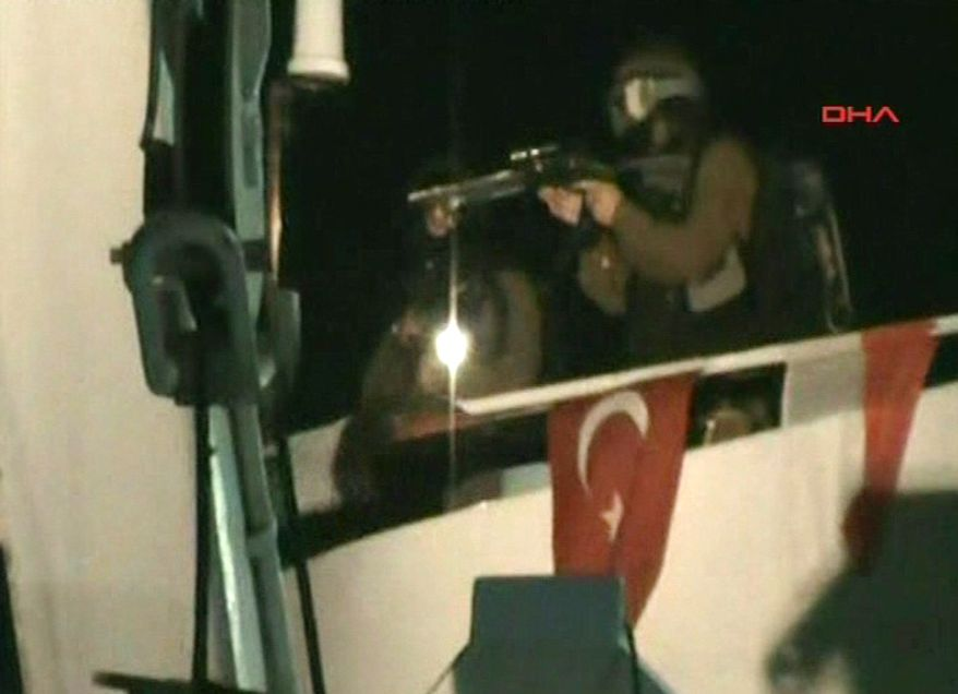 ** FILE ** This video image released by the Turkish aid group IHH on Monday, May 31, 2010, purports to show Israeli soldiers aiming a gun on the deck of a Turkish ship, part of an aid convoy heading to the Gaza Strip, after Israeli soldiers boarded the vessel in international waters off the Gaza coast. Israeli commandos on Monday stormed six ships carrying hundreds of pro-Palestinian activists on an aid mission to the blockaded Gaza Strip, killing at least 9 people and wounding dozens after encountering unexpected resistance as the forces boarded the vessels. (AP Photo/IHH via APTN)