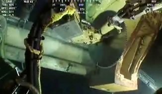 This image made from video released by British Petroleum (BP PLC), equipment is seen on the live feed from the Deepwater Horizon oil rig Tuesday, June 1, 2010. BP has turned to another temporary fix, an effort to saw through the pipe leaking the oil and cap it that could be tried as soon as Wednesday. (AP Photo/BP PLC)