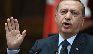 Turkish Prime Minister Recep Tayyip Erdogan addresses lawmakers at the Parliament in Ankara, Turkey, on  Tuesday, June 1, 2010. Mr. Erdogan accused Israel of state terrorism in Monday's commando raid on a flotilla carrying aid for the Gaza Strip. (AP Photo/Burhan Ozbilici)