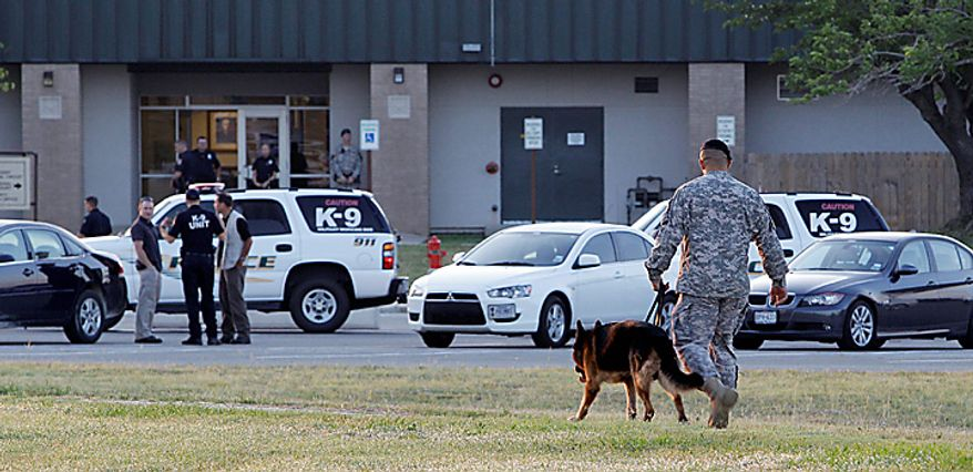 Military police secure the area around the U.S. Magistrate Court before an Article 32 hearing for Maj. Nidal Hasan,Tuesday, June 1, 2010, in Fort Hood, Texas. Maj. Hasan, who is accused of opening fire at Fort Hood and killing 13 and wounding dozens more, was to make his first military courtroom appearance Tuesday as his attorney seeks to delay the case. An Article 32 hearing is similar to a civilian grand jury proceeding, in which a judge hears witness testimony to determine whether the case should go to trial. No date has been set, but authorities have said the trial could be held as early as July 1. (AP Photo/Eric Gay)