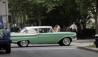 FILE - In this file photo taken June 28, 2007, a 1950s vintage Mercury Montclair auto waits on College Street in New Haven, Conn. Ford Motor Co. announced June 2, 2010, that it would drop its 72-year-old Mercury brand, the latest example of an American auto giant shedding one of its divisions. (AP Photo/Bob Child, File)