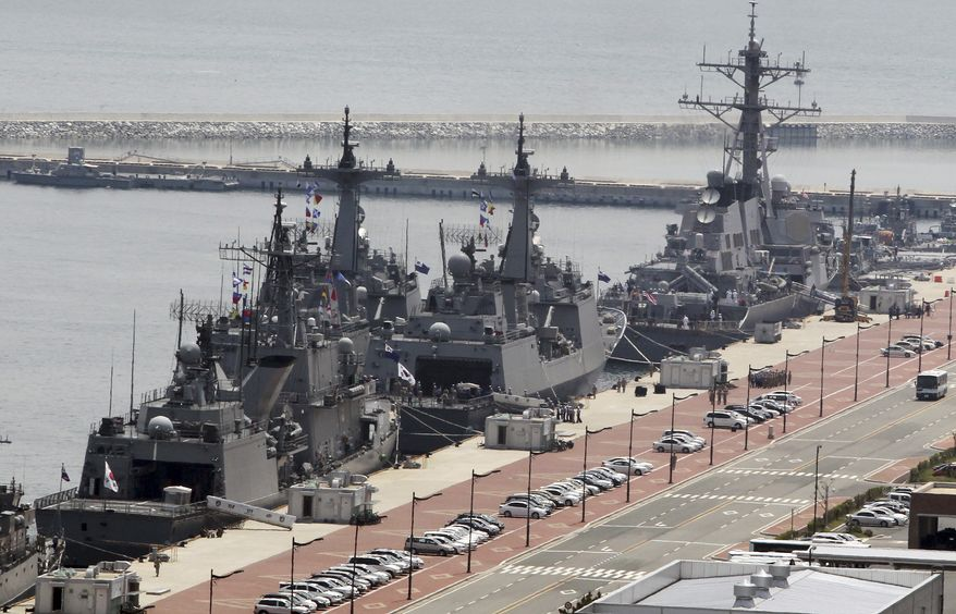 ** FILE ** The USS Curtis Wilbur, a 8,950-ton Aegis destroyer of the U.S. Navy, right, is docked with South Korean navy ships at a naval base in Busan, South Korea, Friday, June 4, 2010. (AP Photo/ Yonhap. Jo Jong-ho)