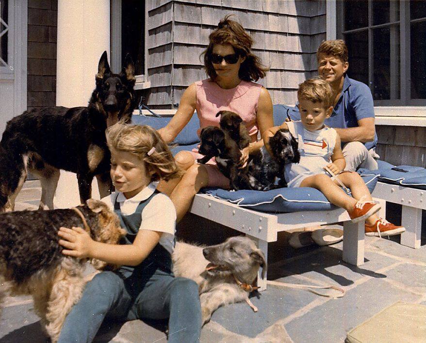 President John F. Kennedy and his family vacation with their pets in this undated photo. From left are daughter Caroline, first lady Jacqueline Kennedy, John Jr. and the president. (AP Photo)