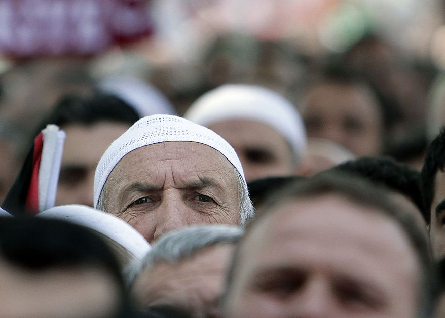 "A man looks on during the funeral of a victim of the Israeli naval commandos raid at the Beyazit mosque in Istanbul, Turkey, Friday, June 4, 2010. The Turkish activists' deaths on the aid ship increased tensions in the Mideast, especially with Turkey. On Thursday, Prime Minister Recep Tayyip Erdogan called Israel's actions ""a historic mistake."" (AP Photo/Vadim Ghirda)"
