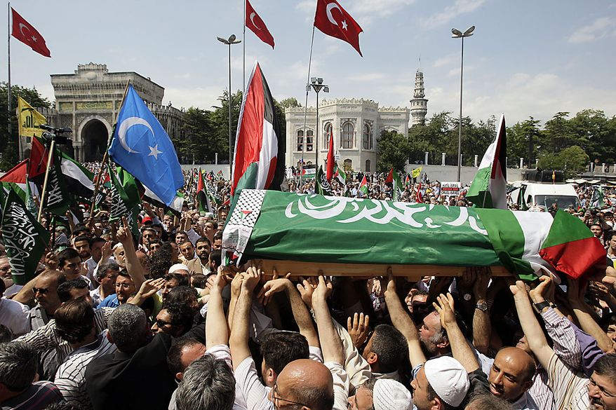 People carry the flag draped coffin of a victim of the Israeli naval commandos raid during the funeral service at the Beyazit mosque in Istanbul, Turkey, Friday, June 4, 2010. In a stunning reversal that illustrated the severity of the diplomatic fallout from its bloody raid on a Gaza-bound flotilla, Israel on Wednesday dropped plans to prosecute dozens of the captured pro-Palestinian activists, moving instead to deport all of them quickly. (AP Photo/Vadim Ghirda)