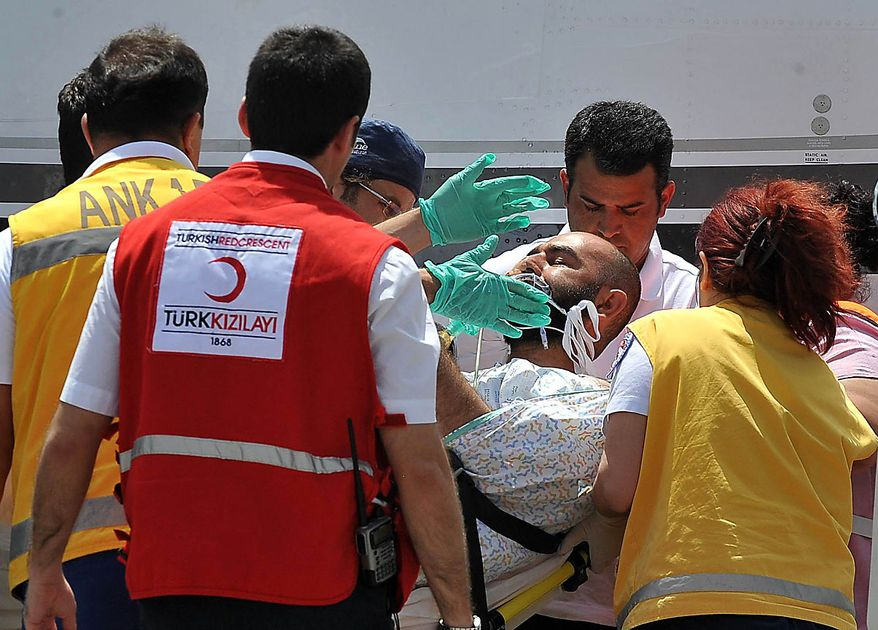 Turkish medics carry an injured activist towards an ambulance, at the Etimesgut military airport in Ankara, Turkey, Friday, June 4, 2010, after he was injured during an Israeli military operation to stop a humanitarian aid flotilla bound for Gaza.  Israeli commandos on Monday stormed six ships carrying hundreds of pro-Palestinian activists on an aid mission to the blockaded Gaza Strip, killing 9 people and wounding dozens after encountering resistance as the forces boarded the vessels. The injured have been released from detention in Israel. (AP Photo)