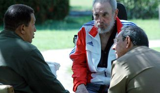 Cuban newspaper Juventud Rebelde released a photo showing Venezuelan President Hugo Chavez (left) visiting Cuban President Raul Castro (right) and former President Fidel Castro in 2008. (Associated Press)