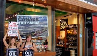 Employees of Lush Cosmetics plan to stage a protest wearing nothing but faux oil-barrel costumes to protest President Obama's energy policies. (Lush Cosmetics)