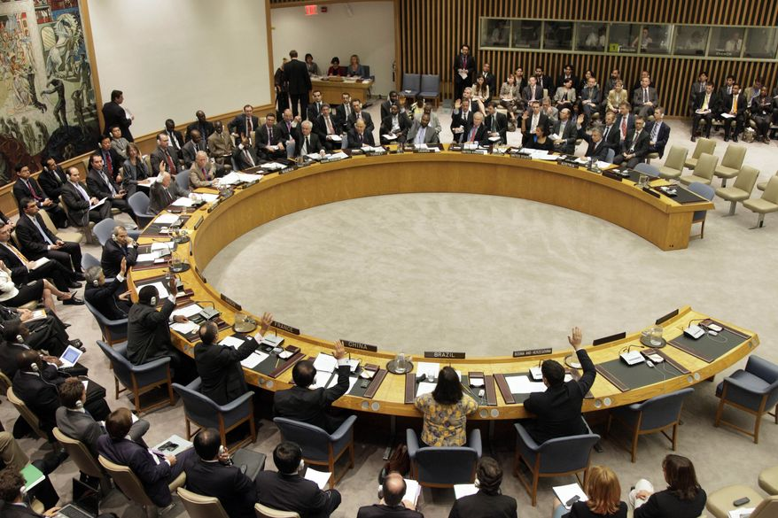 "** FILE ** The members of the U.N. Security Council vote on sanctions against Iran during a session on Wednesday, June 9, 2010. The sanctions would ban Iran from pursuing ""any activity related to ballistic missiles capable of delivering nuclear weapons,"" bar Iranian investment in activities such as uranium mining, and prohibit Iran from buying several categories of heavy weapons, including attack helicopters and missiles. (AP Photo/Richard Drew)"