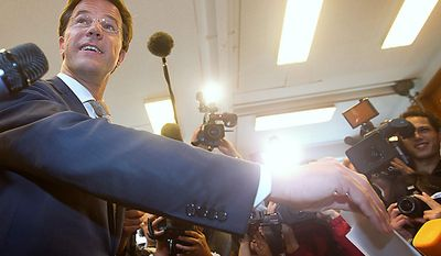 The Netherlands' center-right Liberal Party, led by Mark Rutte, shown in this file photo casting his ballot in general elections June 9, 2010, is in talks to forge a coalition for a three-party government with Maxime Verhagen's Christian Democratic Appeal, backed by the outside support of Geert Wilders's anti-Islam Freedom Party. (AP Photo/Evert-Jan Daniels)