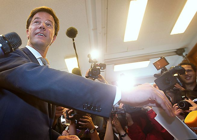 The Netherlands' center-right Liberal Party, led by Mark Rutte, shown in this file photo casting his ballot in general elections June 9, 2010, is in talks to forge a coalition for a three-party government with Maxime Verhagen's Christian Democratic Appeal, backed by the outside support of Geert Wilders's anti-Isla