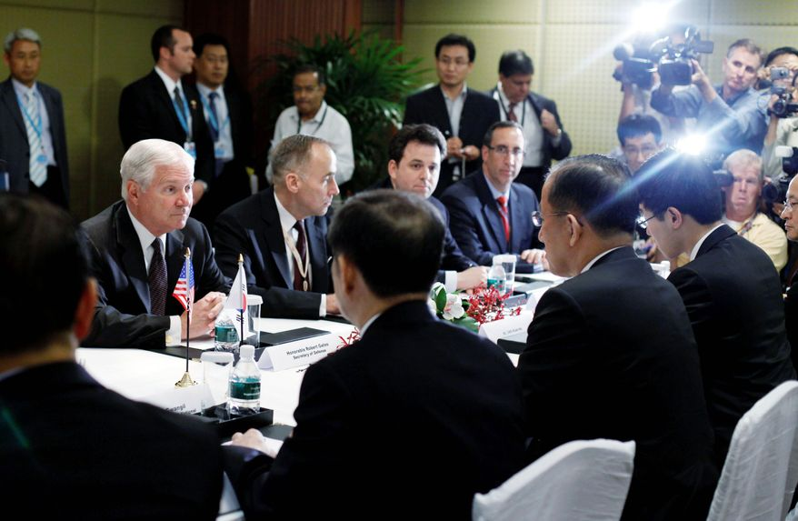ASSOCIATED PRESS Defense Secretary Robert M. Gates (far left) participates in a meeting during the Shangri-La Dialogue's Asia Security Summit in Singapore last Friday.