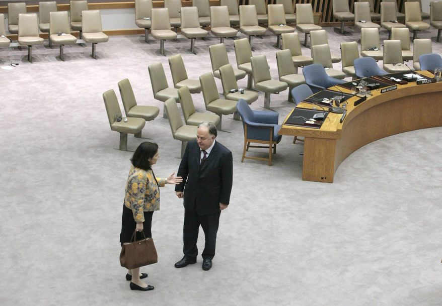 In this file photo, Brazil's United Nations Ambassador Maria Ribeiro Viotti, left, and Turkey's United Nations Ambassador Ertugrul Apakan, are alone to confer inside the United Nations Security Council following a vote to impose sanctions on Iran, New York, Wednesday, June 9, 2010. The two nations were the only members of the council to vote against sanctions, which cited Iran's nuclear buildup. (AP Photo/Bebeto Matthews)