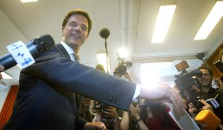 **FILE** VVD Party leader Mark Rutte casts his ballot in the general election in The Hague on June 9, 2010. (Associated Press)