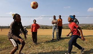South African youths play at a soccer ground in Rustenburg, South Africa, on Thursday, June 10, 2010. (AP Photo/Lee Jin-man)