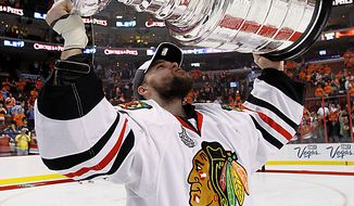 Chicago Blackhawks goalie Antti Niemi, of Finland, looks up at the Stanley Cup after the Blackhawks defeated the Philadelphia Flyers 4-3 in overtime in Game 6 of the Stanley Cup Finals in Philadelphia on Wednesday, June 9, 2010. (AP Photo/Matt Slocum)