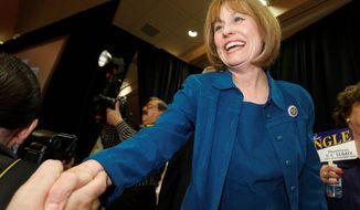 **FILE** Sharron Angle shakes hands of supporters in Las Vegas on June 8, 2010, after winning the Nevada Republican U.S. Senate primary election race. Angle will face Sen. Harry Reid in November. (Associated Press)