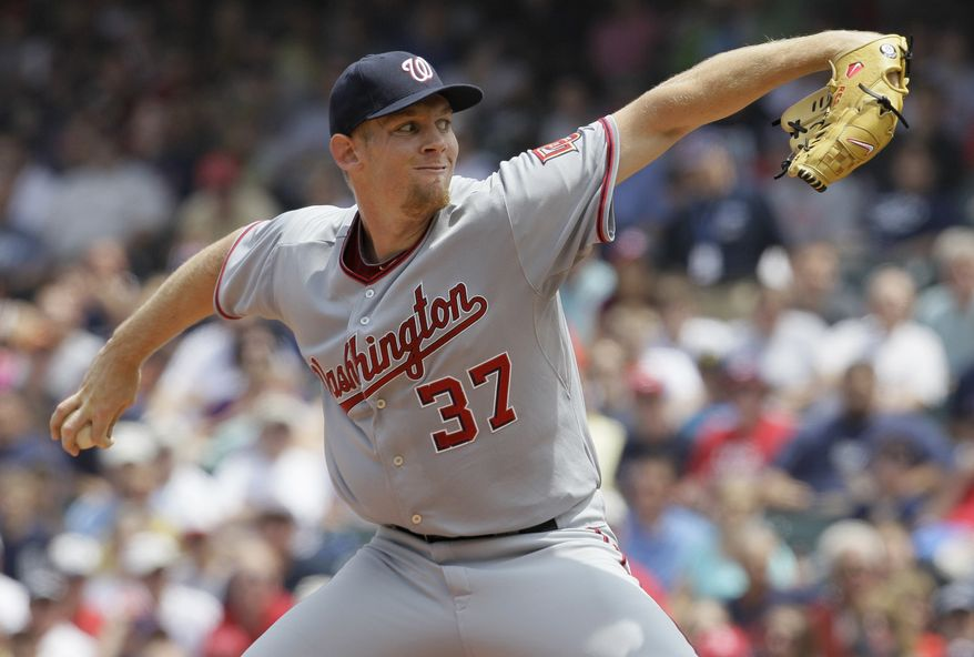 Washington Nationals starting pitcher Stephen Strasburg throws during a game against the Cleveland Indians last season. Currently, Strasburg is rehabbing from Tommy John surgery. (Associated Press)