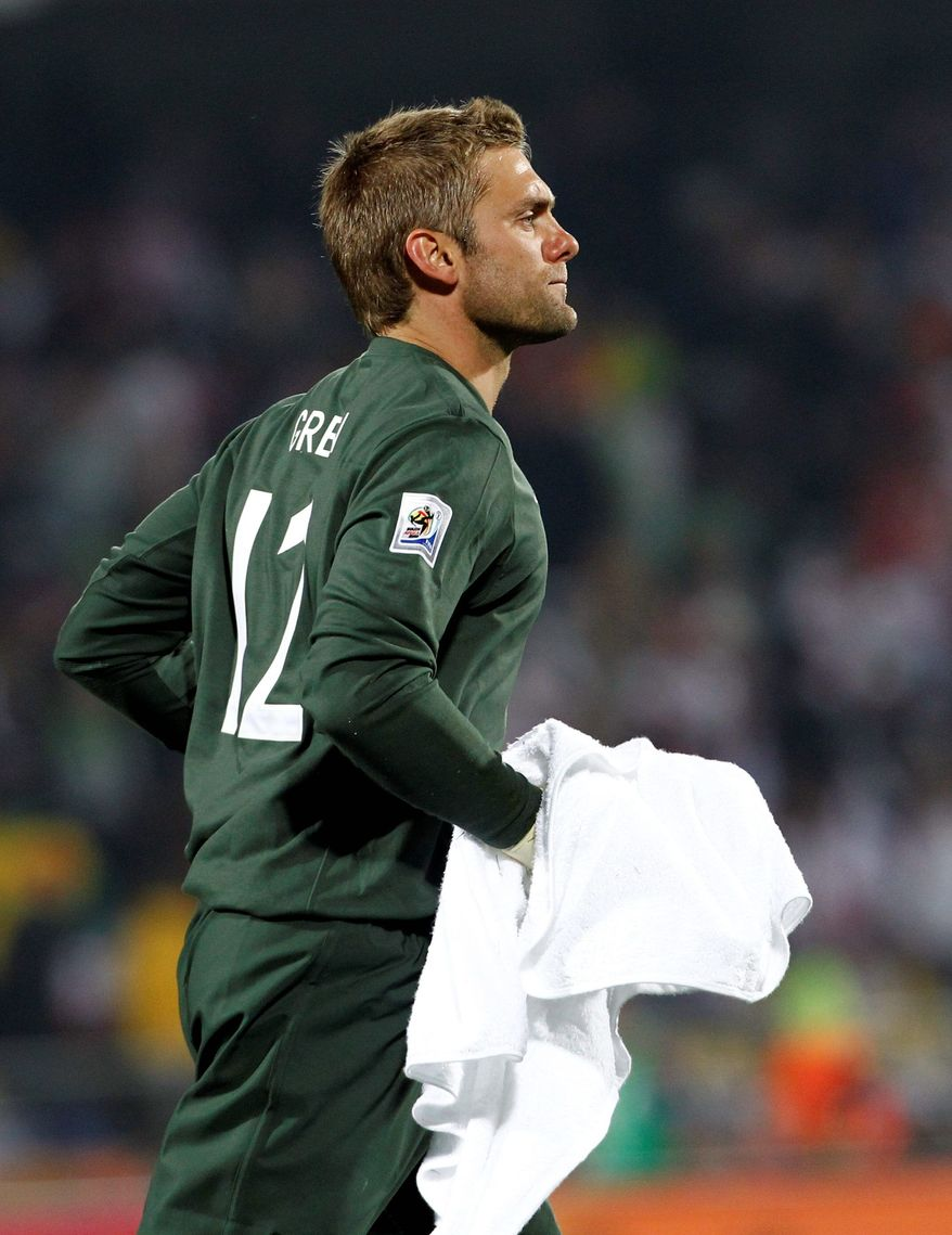 A single mishap at the World Cup game against the United States on Saturday could forever define the career of English goalie Robert Green. (Associated Press)