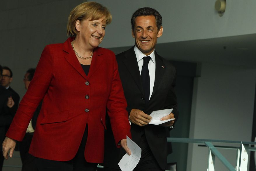 German Chancellor Angela Merkel (left) and French President Nicolas Sarkozy arrive Monday at a news conference during a meeting at the chancellery in Berlin to prepare for a European Union summit later this week, amid speculation of a rift in German-French views on economic policy. Merkel welcomed Sarkozy to discuss a joint strategy on how to curb the debt crisis that has dragged down the common European currency and rattled economies across the continent. (Associated Press)