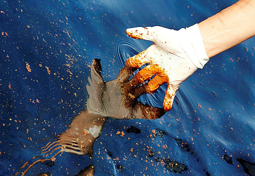 Oil sticks to the glove of a reporter in the Gulf of Mexico, about 17 miles off the coast of Pensacola, Fla., on Sunday, June 13, 2010. BP PLC sent a revised oil-capture plan for its leaking Gulf of Mexico well to the Obama administration as the government demanded an escrow account for damages claims related to the biggest petroleum spill in the nation's history. (Bloomberg News/Kari Goodnough)