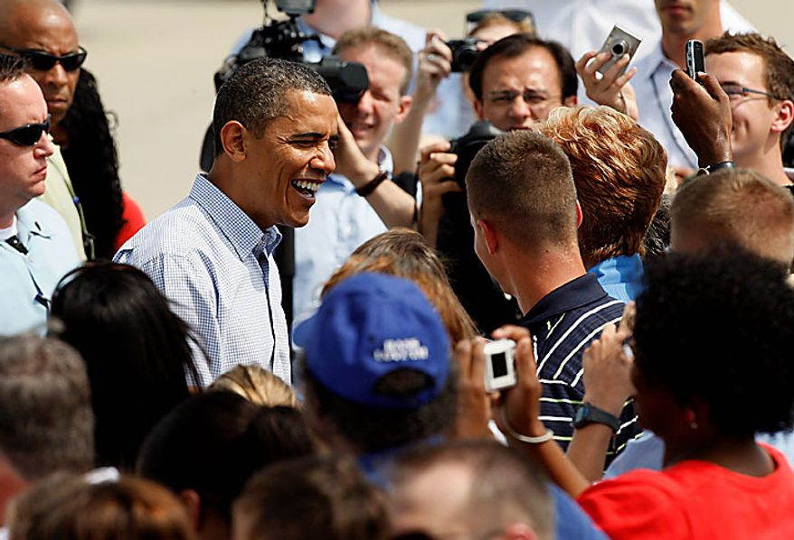 President Obama greets visitors on the tarmac at Gulfport-Biloxi International Airport in Gulfport, Miss., on Monday, June 14, 2010. This is Mr. Obama's fourth trip to the Gulf Coast since April's Deepwater Horizon oil rig explosion and oil spill in the Gulf of Mexico. (AP Photo/Patrick Semansky)