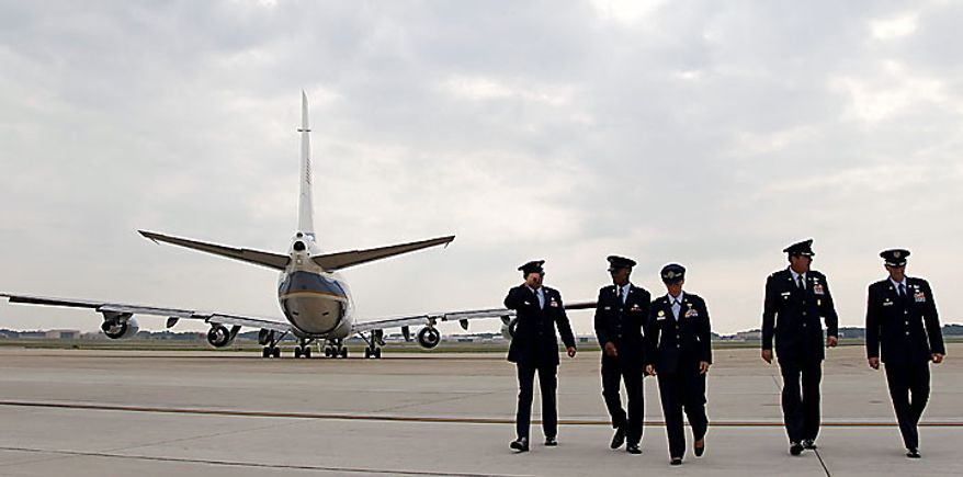 Air Force personnel walk off the flight line as President Obama departs aboard Air Force One on Monday, June 14, 2010, at Andrews Air Force Base in suburban Washington. (AP Photo/Haraz N. Ghanbari)