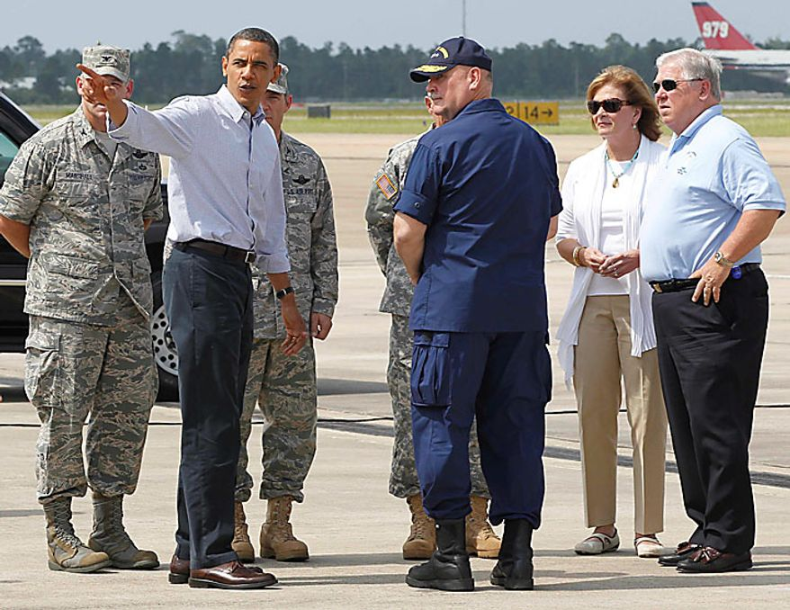 President Obama stands with Mississippi Gov. Haley Barbour (right); Mr. Barbour's wife, Marsha (second from right); and U.S. Coast Guard Adm. Thad Allen (center) after stepping off Air Force One at Gulfport-BIloxi International Airport in Gulfport, Miss., on Monday, June 14, 2010, on a visit to the Gulf Coast affected by the BP Deepwater Horizon oil spill. (AP Photo/Charles Dharapak)