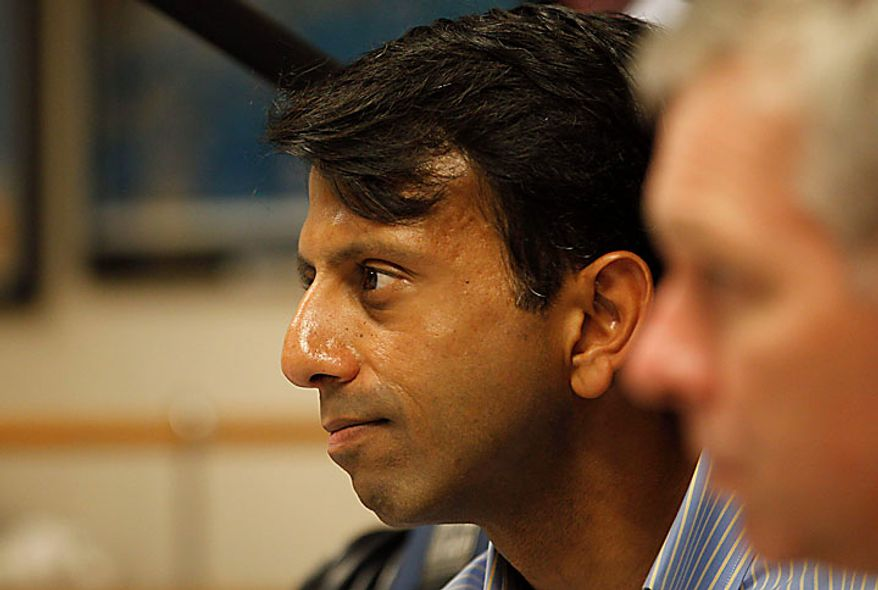 Louisiana Gov. Bobby Jindal looks on as President Obama talks about the BP Deepwater Horizon oil spill on Monday, June 14, 2010, at the U.S. Coast Guard Station in Gulfport, Miss. (AP Photo/Charles Dharapak)