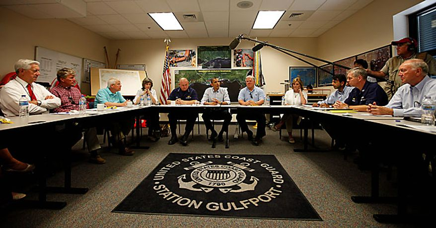 President Obama talks about the BP Deepwater Horizon oil spill on Monday, June 14, 2010, at the U.S. Coast Guard Station in Gulfport, Miss. At the far end of the table are (from left) Carol M. Browner, White House climate and energy adviser; U.S. Coast Guard Adm. Thad Allen, the national incident commander; Mr. Obama; Mississippi Gov. Haley Barbour; Mr. Barbour's wife, Marsha; and Louisiana Gov. Bobby Jindal. (AP Photo/Charles Dharapak)