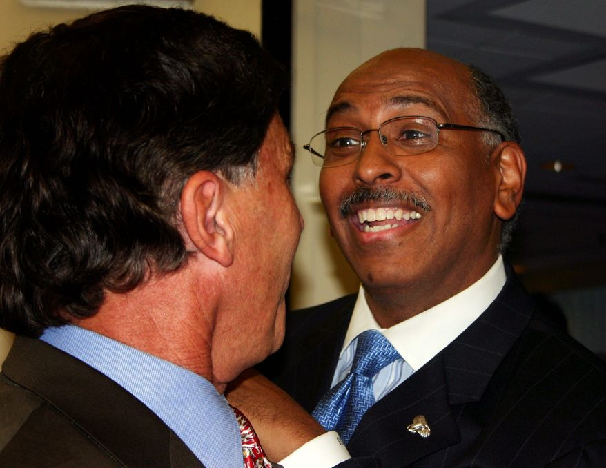 ASSOCIATED PRESS Republican National Committee Chairman Michael S. Steele (right) greets his old boss, former Maryland Gov. Robert L. Ehrlich Jr., at a June 2010 fundraising dinner in Linthicum, Md. The RNC launched a new website on Tuesday, June 22, 2010, mocking President Obama's Chicago-style politics.