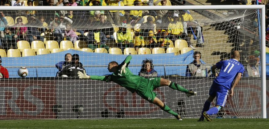 Slovakia's Robert Vittek, right, scores a goal against New Zealand goalkeeper Mark Paston, center, during the World Cup group F soccer match between New Zealand and Slovakia at Royal Bafokeng Stadium in Rustenburg, South Africa, on Tuesday, June 15, 2010. (AP Photo/Lee Jin-man)
