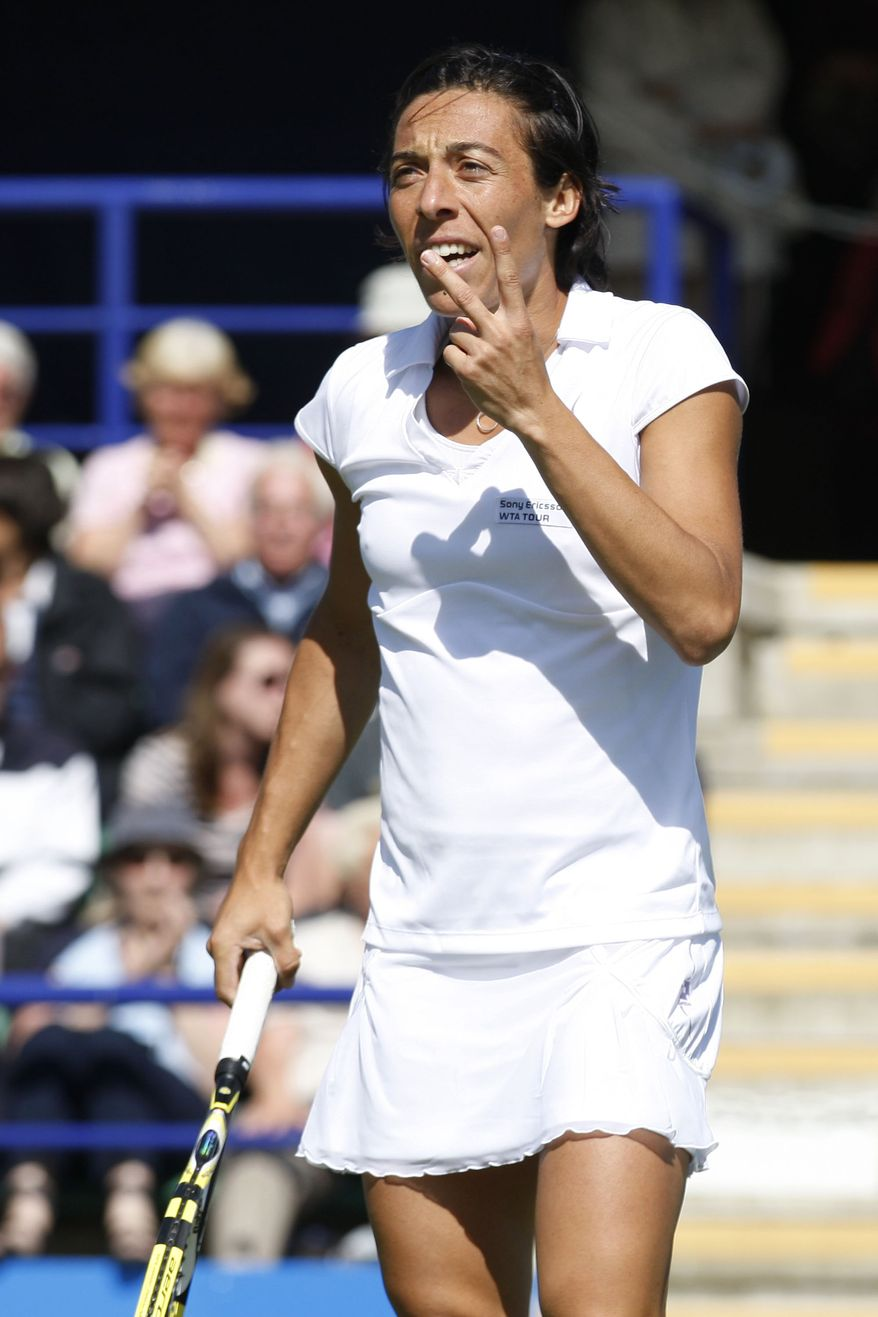 Francesca Schiavone of Italy reacts to a referee decision against her during her first round tennis match against Sorana Cirstea of Romania at Eastbourne International grass court championships, Eastbourne, England, Tuesday, June 15, 2010. Cirstea won by 7-5, 6-3. (AP Photo/Sang Tan)