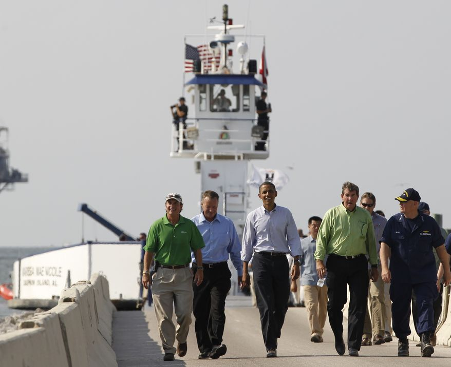 President Obama (center) steps off a ferry from Dauphin Island, Ala., to Fort Morgan, Ala., as he visits the Gulf Coast region affected by the BP Deepwater Horizon oil spill on Monday, June 14, 2010. With the president are (from left) Gulf Shores, Ala., Mayor Robert Craft; Dauphin Island Mayor Jeff Collier; Alabama Gov. Bob Riley; and U.S. Coast Guard Adm. Thad Allen, the national incident commander. (AP Photo/Charles Dharapak)