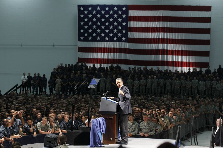 President Obama speaks to military personnel at Naval Air Station Pensacola's Naval Air Technical Training Center in Pensacola, Fla., Tuesday, June 15, 2010, after his visit to the Gulf Coast region affected by the BP Deepwater Horizon oil spill. (AP Photo/Charles Dharapak)