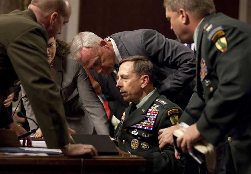 Commander of the U.S. Central Command, Gen. David Petraeus, is surrounded by staff after appearing to pass out on Capitol Hill in Washington, Tuesday, June 15, 2010, while testifing before the Senate Armed Services Committee. Gen. Petraeus, who was dehydrated, left the room but returned after 20 minutes. (AP Photo/Evan Vucci)