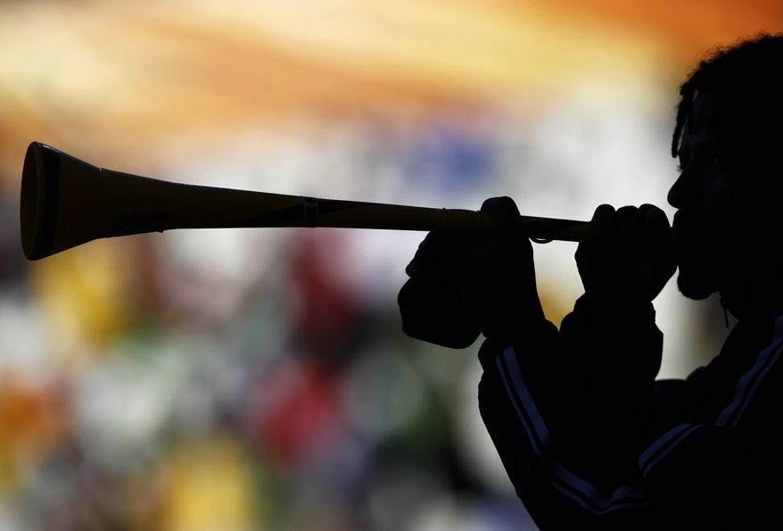 A soccer fan blows a vuvuzela prior to the World Cup group E soccer match between Japan and Cameroon at Free State Stadium in Bloemfontein, South Africa, Monday, June 14, 2010. (AP Photo/Bernat Armangue)
