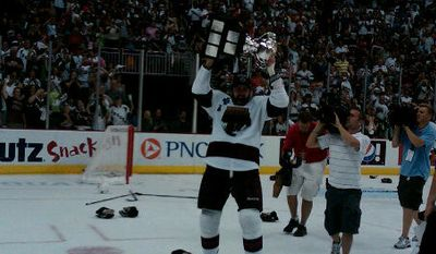 The Hershey Bears celebrate their third Calder Cup title in five years. (Ted Starkey/The Washington Times)