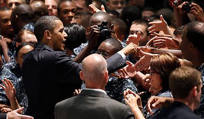 President Obama greets military personnel at Naval Air Station Pensacola's Naval Air Technical Training Center in Pensacola, Fla., Tuesday, June 15, 2010, after his visit to the Gulf Coast region affected by the BP Deepwater Horizon oil spill. (AP Photo/Charles Dharapak)